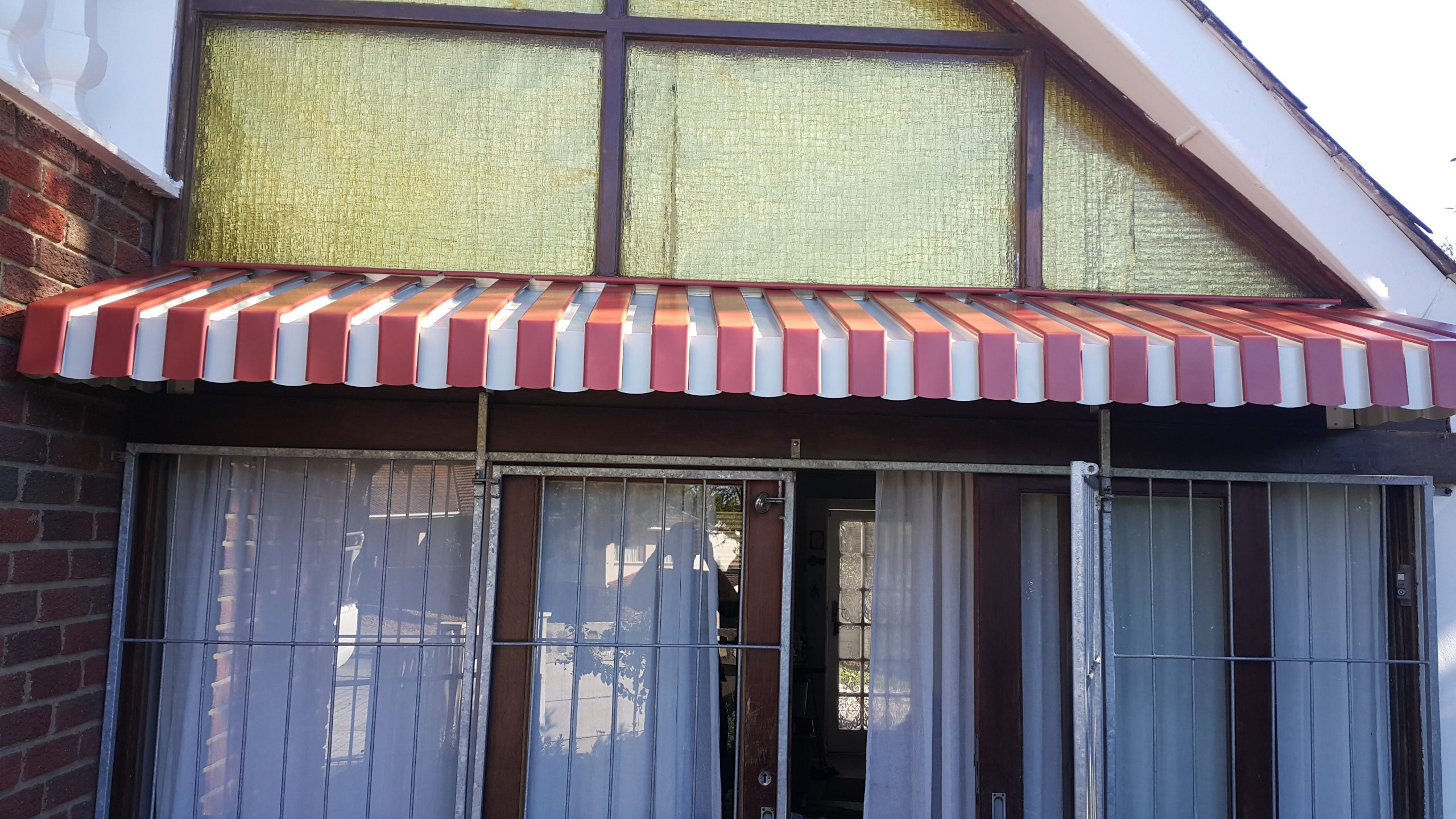 Patio Awning installation protects the outdoor patio