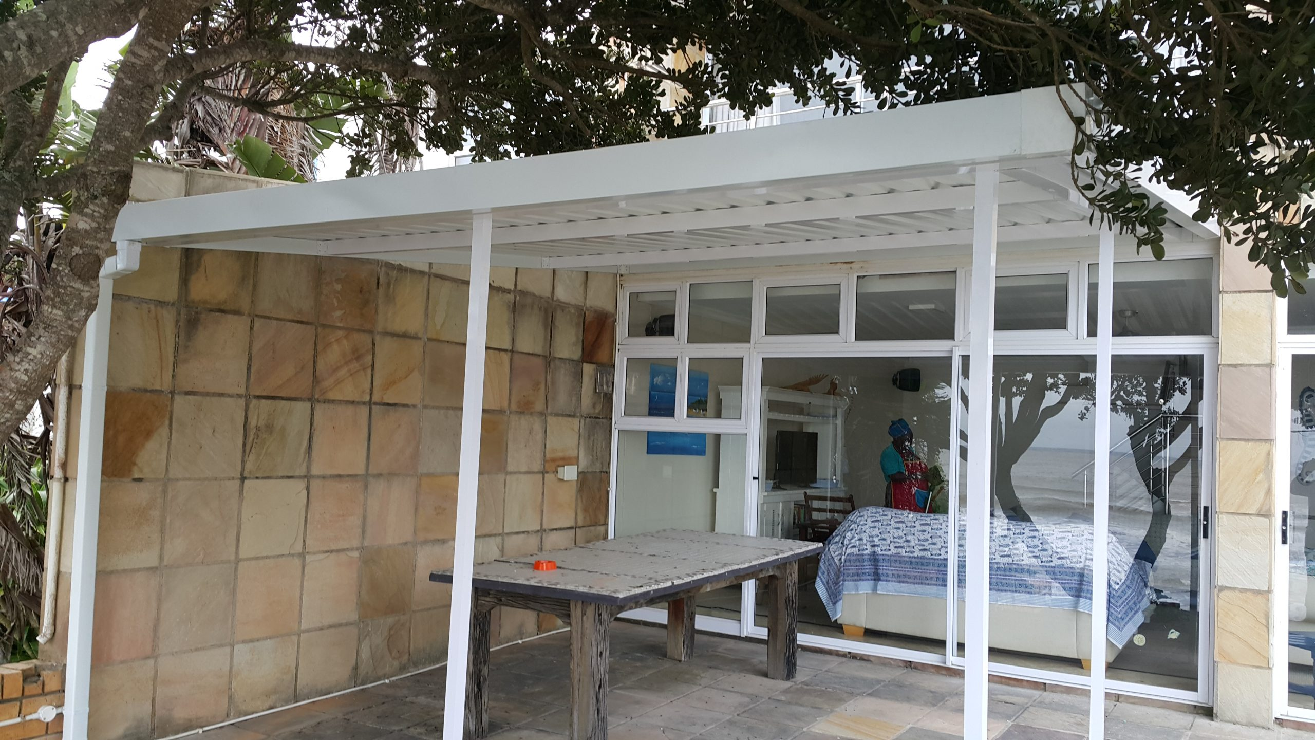 Patio awning installation extends the outdoor patio